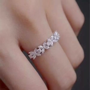 Floral style super sparkly half-stoned band/ring